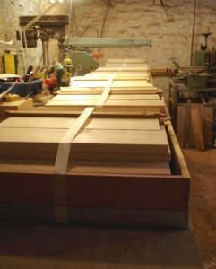 flat pack national hives lined up for collection